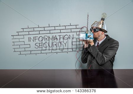 Information security text with vintage businessman kissing machine