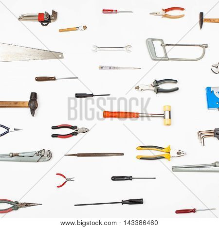 Many Small Tools Arranged On White