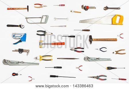 Many Hand Tools Arranged On White