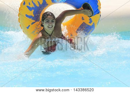 Rhodes Greece-August 14 2016:The girl after rafting slide in the Water park.Rafting slide is one of many popular game for adults and children in park.Water Water Park is located on the island of Rhodes in Greece and one of the most largest in Europe