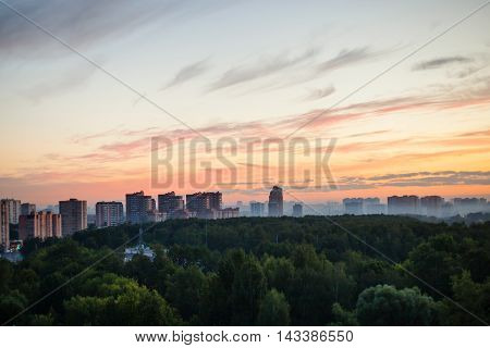 Morning Mist Over Woods And City At Dawn