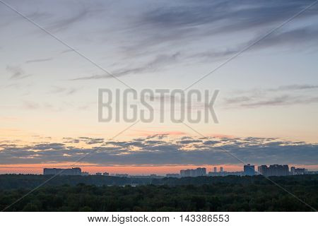 Blue Sky With Pink Horizon Over City