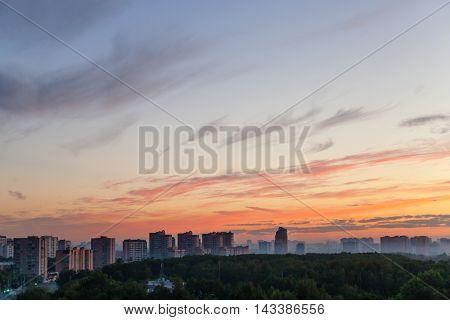 Blue Sky With Orange Sunlight Over City