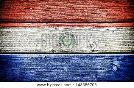 flag of Paraguay painted on old grungy wooden background: 3d illustration