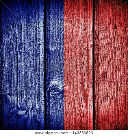 flag of Paris painted on old grungy wooden background