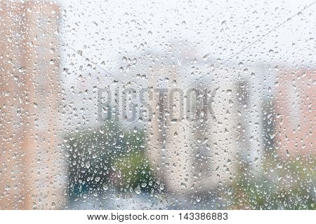 View Of Raindrops On Window Glass Of Urban House