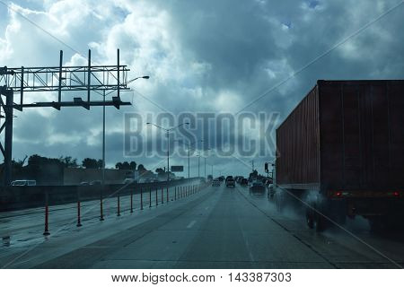 Miami Florida rainy driving road with trucks traffic