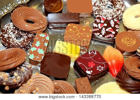 Decorated Christmas chocolates in various shapes and sizes