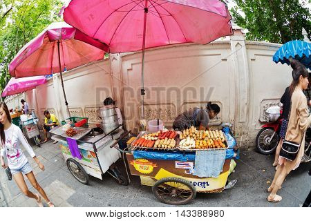 BANGKOK, THAILAND- APRIL 29, 2015: street vendors expect buyers on one of the central streets of Bangkok. Government statistics indicate 16,000 registered street vendors in the Thai capital.