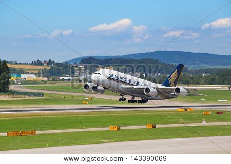 ZURICH - July 30:  A-380 Singapore Airlines taking off from Zurich Airport on July 30, 2016 in Zurich, Switzerland. Zurich airport is home port for Swiss Air and one of the european hubs.