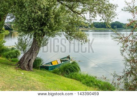 Boat On The Lake Under A Tree