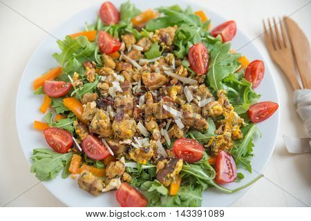 healthy Salad with vegetables, chanterelles and croutons