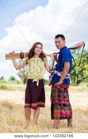 Thai costume and ancient musical instrument, Thailand