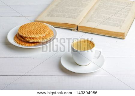 Cup Of Espresso. Waffles And Book