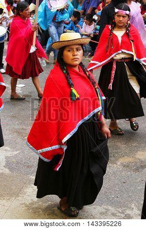 Cajamarca Peru - February 8 2016: Peruvian woman in traditional costume marches in Carnival parade in Cajamarca Peru on February 8 2016