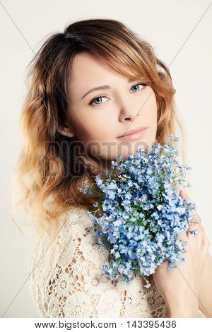 Pretty Woman Holding Blue Flowers on white