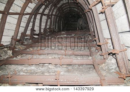old dark industrial abandoned coal mine tunnel