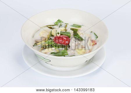 Tom kha gaichicken soup in coconut milkstraw mushroom and kaffir lime leaves.Thai food in a luxury hotel.