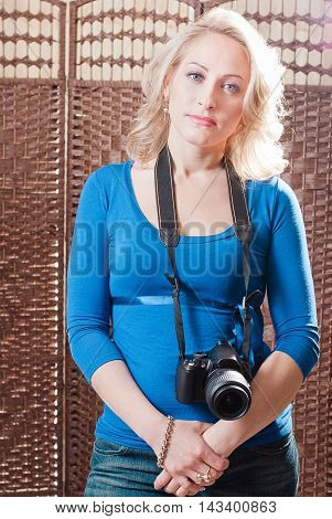 Beautiful Woman Standing With Camera Around Her Neck