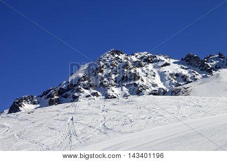 Ski Slope And Snow Rocks
