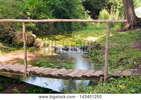 Small Bridge Over A Water Stream