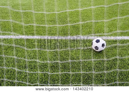 Photo of a Soccer ball upon the green grass