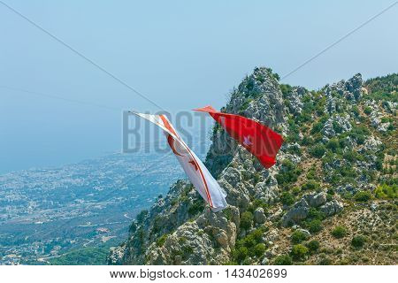Enormous Turkey and North Cyprus flags between mountains near Saint Hilarion castle Kyrenia mountain range North Cyprus