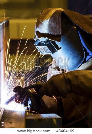 Sparks and jets of smoke when welding of steel structures semi-automatic welding in shielding gases