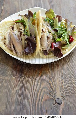 Tacos with chicken and vegetable salad, vertical