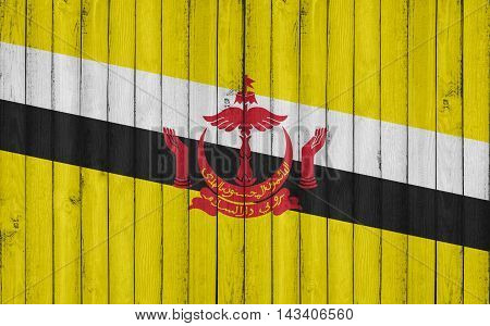 Flag of Brunei painted on wooden frame