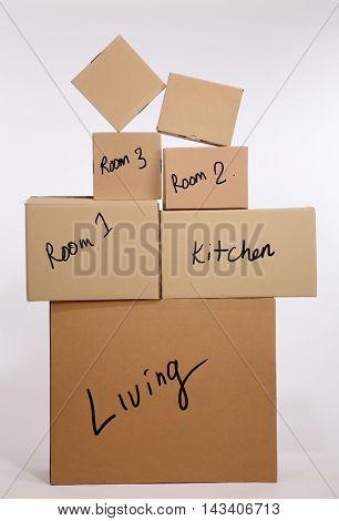 stack of brown cardboard box with label