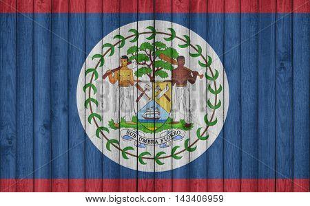 Flag of Belize painted on wooden frame