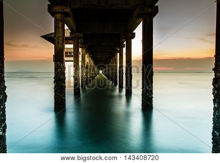 Wood jetty on the Beach and tropical seaEast of Thailand.