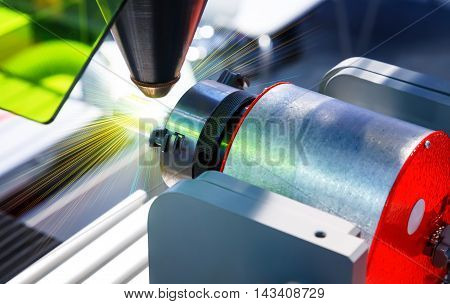 Laser cutting of metal on a lathe with program.