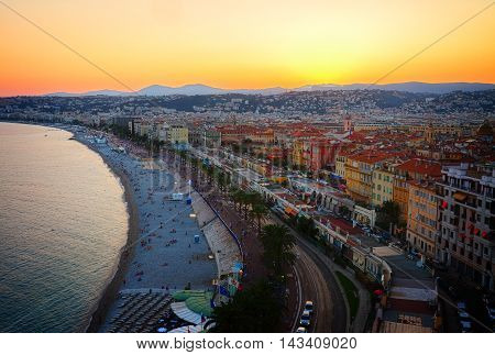 cityscape of Nice city with beach and sea at sunset, France, toned