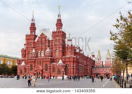 MOSCOW - SEPTEMBER 22 2015: Tourists walking in front of State Historical Museum of Russia. There are more than a million objects dedicated to history of the country.