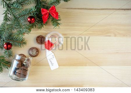 New Year's and Christmas. Sprigs of trees decorated with toys. Near Christmas decorations, glass of milk and cookies left for Santa Claus specifically. Copy space