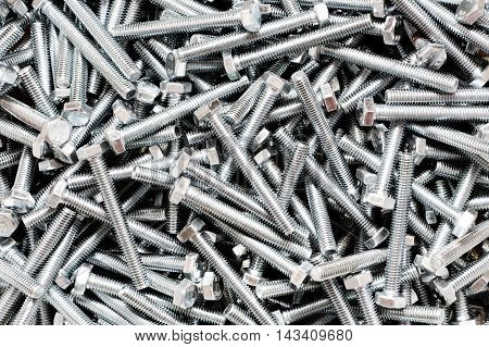 A lot of bolts and screws for a background