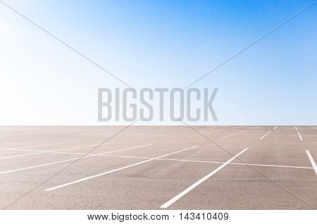 Empty outdoor car park on the sky background