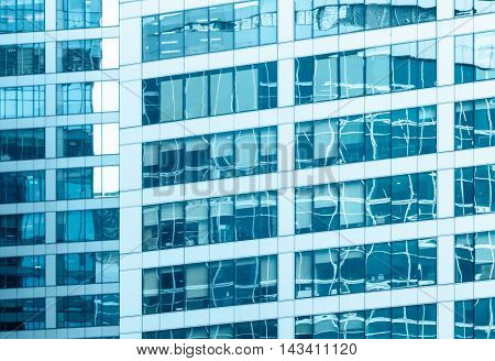 Close-up of the glass office building with reflections.