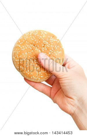 Close-up Image Of A Human's Hand With Tasty Hamburger Over The W