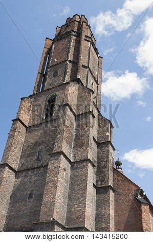 Poland Silesia GliwiceAll Saints church tower seen from south-east sunlit cluouds in the sky
