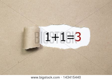 1+1=3 written under torn Brown paper.Business, technology, internet concept.