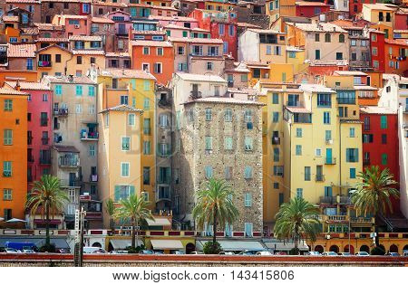 facades of colorful houses of Menton old town, France, retro toned