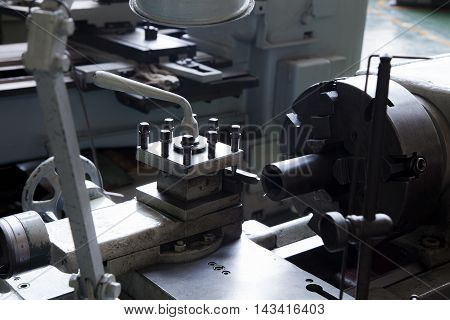 old lathe round handle lathe Industrial lathe tool and part of the lathelathe machine