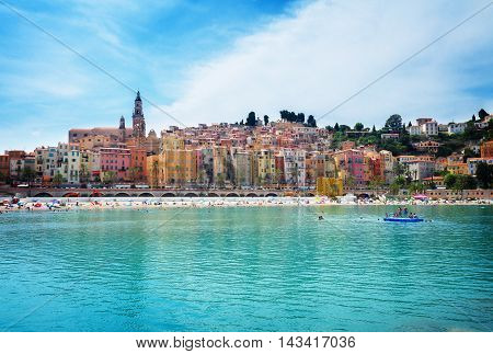 colorful houses of Menton old town waterfront, France, toned
