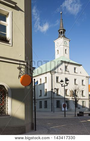 Poland Upper Silesia Gliwice sunlit town hall at market square and wall of a tenemrnt