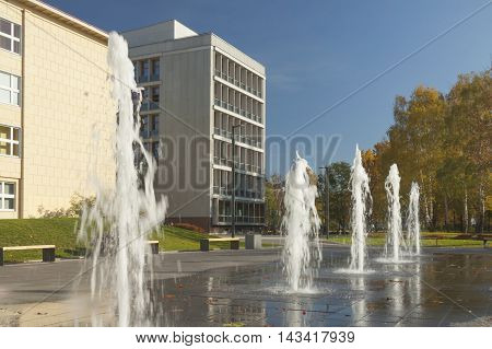 Poland Upper Silesia Gliwice Silesian Polytechnics Campus fountain sunlit midday