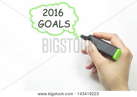 Hand writing 2016 goals concept with green marker on transparent wipe board. talk bubble