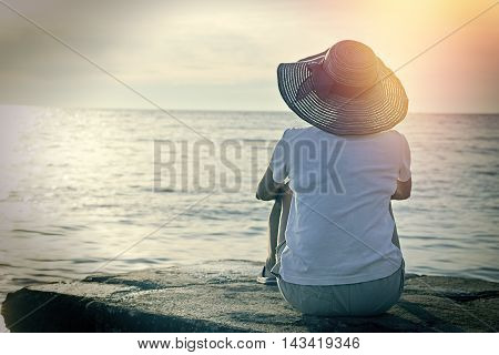 Enjoys in vacation, enjoys in landscape - relaxing on the beach in the evening sunset